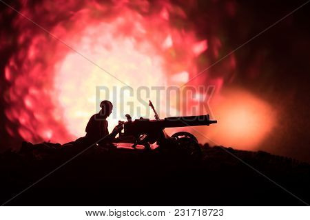 Man With Machine Gun At Night, Fire Explosion Background Or Military Silhouettes Fighting Scene On W