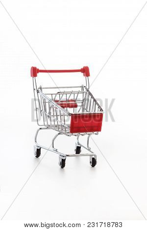 Close Up Of Supermarket Grocery Push Cart For Shopping With Black Wheels And Plastic Elements On Han