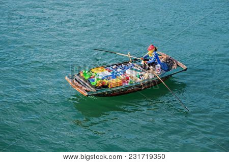 Halong, Vietnam, May 15, 2017: Floating Market, Ha Long Bay, Vietnam. Woman Sells Drinks And Snacks