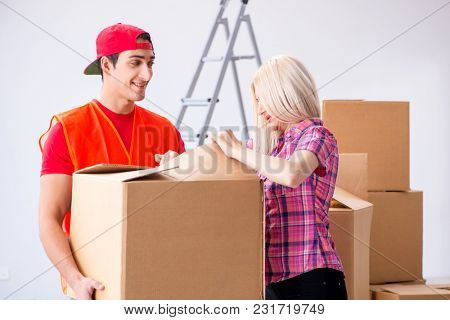 Young delivery assistant delivering to home