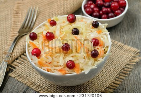 Salad With Cabbage, Carrots And Cranberries In White Bowl