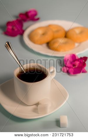 A Cup Of Coffee On The Table. Coffee With Shortbread Cookies. Coffee On The Table Is Decorated With