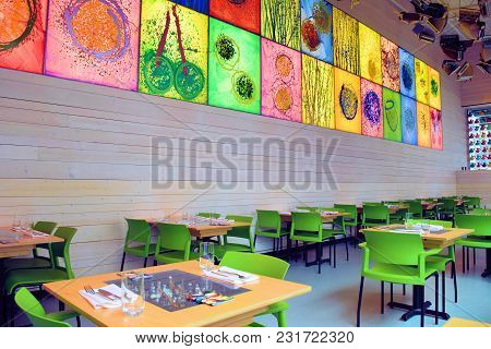 March 7, 2018 In Seattle, Wa:  Colorful Seating Surrounded By Art Taken At The Collections Café In T