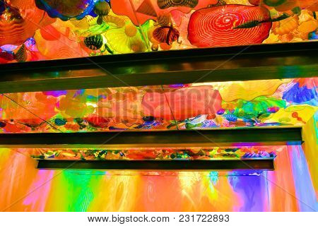 March 7, 2018 In Seattle, Wa:  Light Coming Thru A Ceiling With Glass Sculptures Creating Colorful L