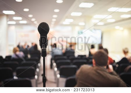Microphone On Conference In Presentation Holl Close-up With Blurred Background