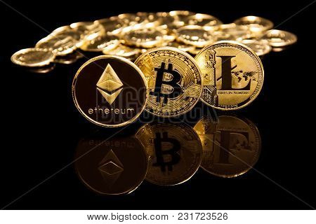 Criptocurrency Concept Of Bitcoin And Litecion Coins On Black Mirror Surface Next To Golden Coins
