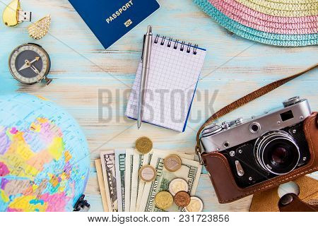 Accessories For Trip Planing On Blue Wooden Background Old Photocamera Compass With Passport And Dol