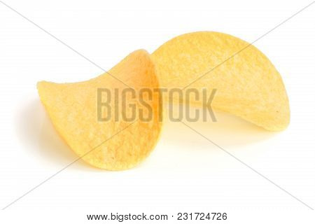 Two Potato Chips On White Background Close-up.
