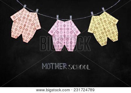 Baby Girl Clothing On Clothesline Mother School On Blackboard Background