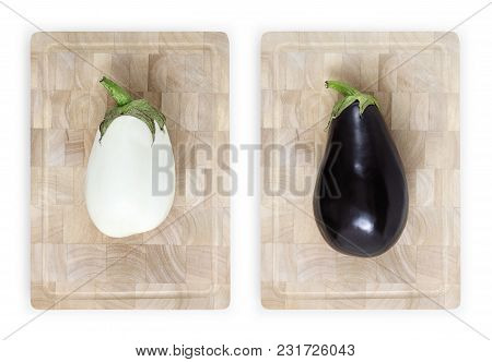 White And Black Eggplants On Wooden Cutting Board Food Top View Isolated On White