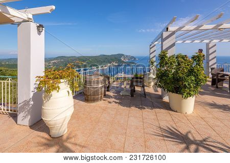 Corfu Greece - May 10, 2016: Restaurant Terrace With View Of Beautiful Bay Of Palaiokastritsa. Corfu
