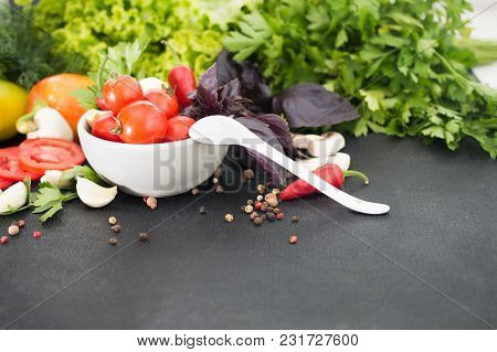 Fresh Tomatoes, Basil, Other Greens  In A White Bowl On A Black Background