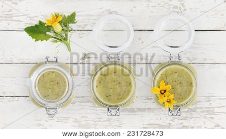 Zucchini Sauce Jar And Flowers Food Top View Isolated On White Wooden Kitchen Worktop