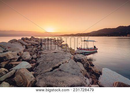 Boat Anchoring In Port Of Roda Village. Sunrise Time. Corfu Island