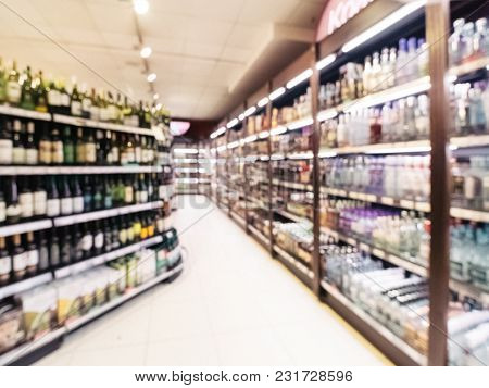 Abstract Blurred Supermarket Colorful Shelves With Alcohol, Wine Bottles As Background