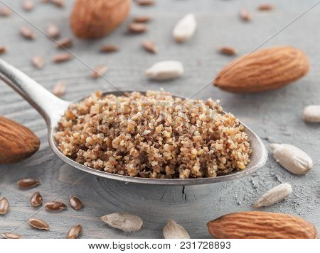 Homemade Lsa Mix In Spoon - Linseed Or Flax Seeds, Sunflower Seeds And Almonds. Traditional Australi