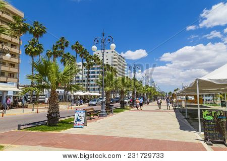 19 Of May 2016. Cyprus. Larnaca City.  Wide Modern Embankment In The Background Of A Blue Cloudy Sky
