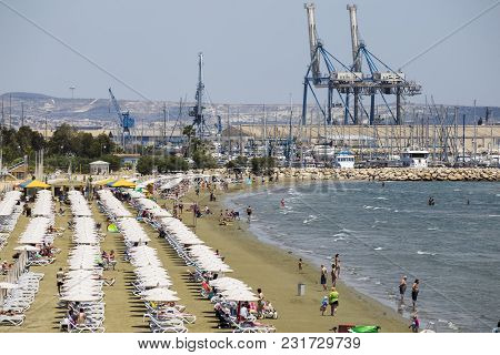 19 Of May 2016. Cyprus. Larnaca City,  Finikoudes Beach. Tourists Are Resting On The Coast. White Um