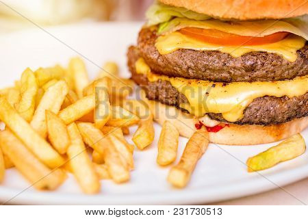 Burger Close Up With Fresh Tomato, Cheese, Meat And French Fries. Fast Food Concept