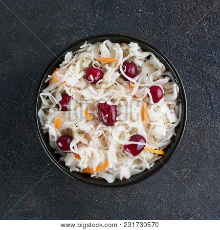 Traditional Russian Appetizer Sauerkraut With Cranberry And Carrot In Dark Bowl On Black Cement Back