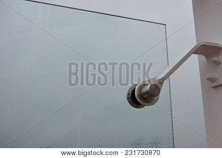 Vacuum Suckers For Glass. Application In Real Conditions In The Open Air In The Rain.