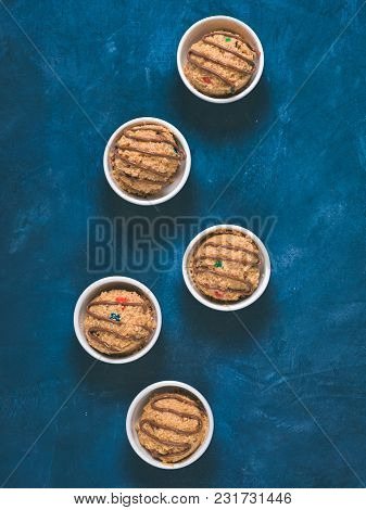 Safe-to-eat Raw Monster Cookie Dough In Small Portion Bowl On Blue Background. Ideas And Recipes For