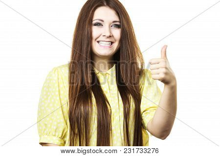 Portrait Of Beautiful Young Woman With Long Brown Hair. Female Being Positive Showing Thumb Up Gestu
