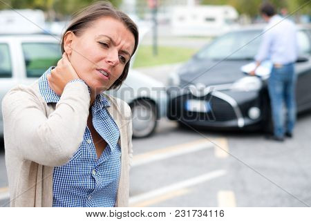 Woman Feeling Pain After Car Accident In The City