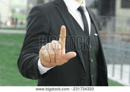 Close Up. Businessman Showing Index Finger Up.