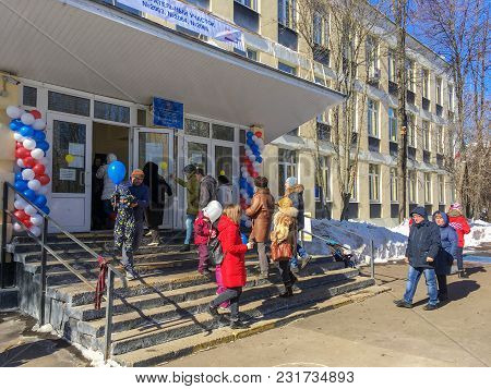 Moscow, Russia - March 18, 2018: Voters Enter A Polling Station To Take Part In Voting On Elections
