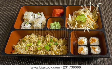 Business Lunch In Japanese Style Of Several Dishes In Ceramic Lunch-box