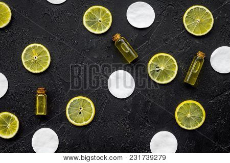 Spa Pattern With Lemon And Cotton Disc On Black Table Background Top View