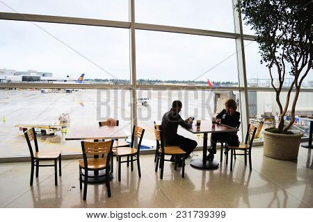 March 8, 2018 In Seattle, Wa:  People Relaxing At The Seattle/tacoma International Airport Which Has