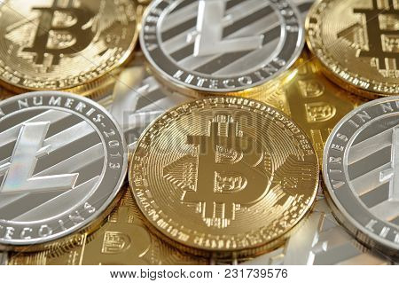 Many Golden Bitcoins And Silver Litecoins As Conceptual Background For Cryptocurrency. Luxury And In