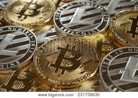 Mix Of Golden Bitcoin And Silver Litecoin Coins Mixed Together. Cryptocurrency Background Image.