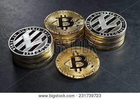 Three Stack Of Cryptocurrency Coins With Single Bitcoin And Litecoin. Golden Bitcoins And Silver Lit
