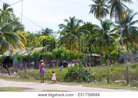 The Dominican Republic, The Caribbean Sea, The Island Of Saona, The Village Of Mano Juan. A Woman An
