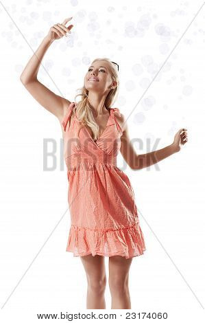 Blond Beautiful Girl Playing With Soap Bubbles Against White Background