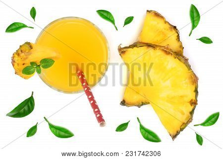 Pineapple Juice In A Glass With Pineapple Slices Isolated On White Background. Top View.