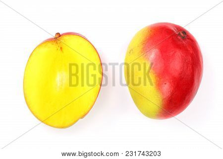 Mango Fruit And Half Isolated On White Background Close-up. Top View. Flat Lay.