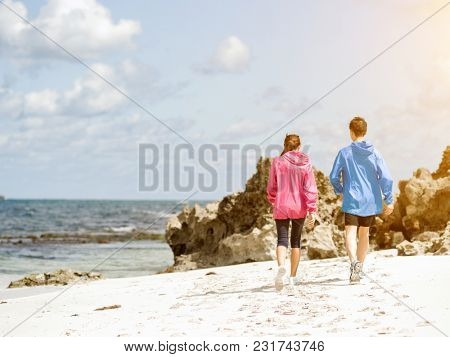 Young Couple Running along sea shore