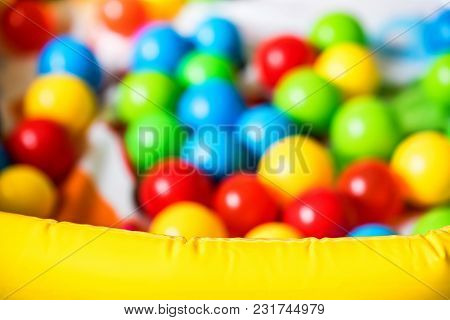 Defocused Image Of Many Colorful Plastic Balls In Ball Pit