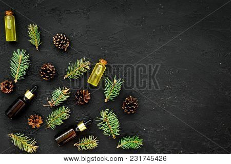 Pine Spa Cosmetics, Products For Skin Care. Fir Essential Oil Near Branches And Cones On Dark Backgr