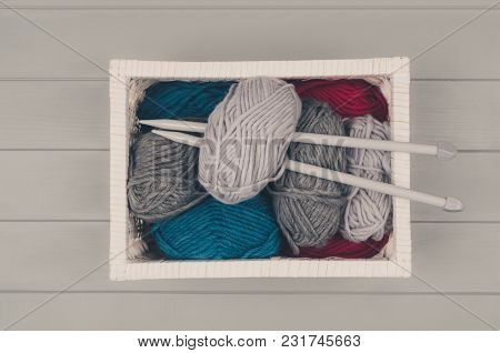 Knitting Accessories Assortment Background With Wool And Needles On Gray Wooden Table. Photograph Ta