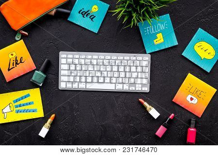 Beauty Bloger Workplace Concept. Keyboard, Cosmetics, Social Media Icons On Black Desk Top View.