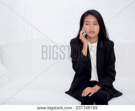 Beautiful Young Asian Woman Talking Phone And Smile In The Living Room, Businesswoman Sitting On Sof