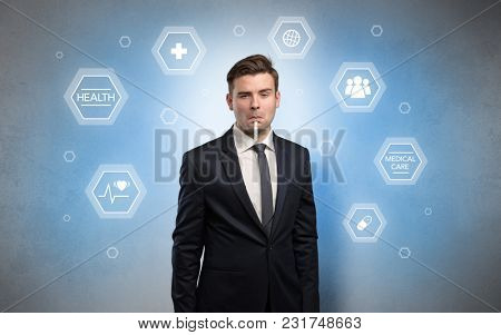 Young businessman with medical care, pills concept