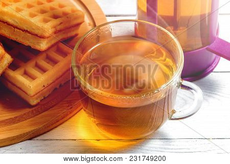 Homemade Waffles With Jam On Old Wooden Table. Wafers With Cup Of Tea And Teapot
