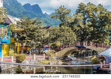 Small Oriental Village On The Island Of Langkawi Surrounded By Mountains Populated With Vegetation.