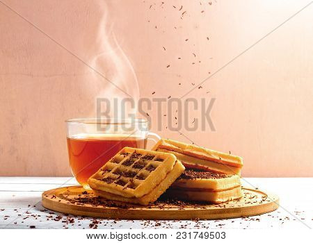 Homemade Waffles With Jam On Old Wooden Table. Wafers With Cup Of Tea, Teapot, Chocolate